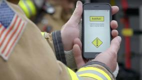 Firefighter views the AskRail app on mobile phone