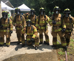 Cohort 7 fellows geared up in PPE on first day of academy in DeKalb, GA